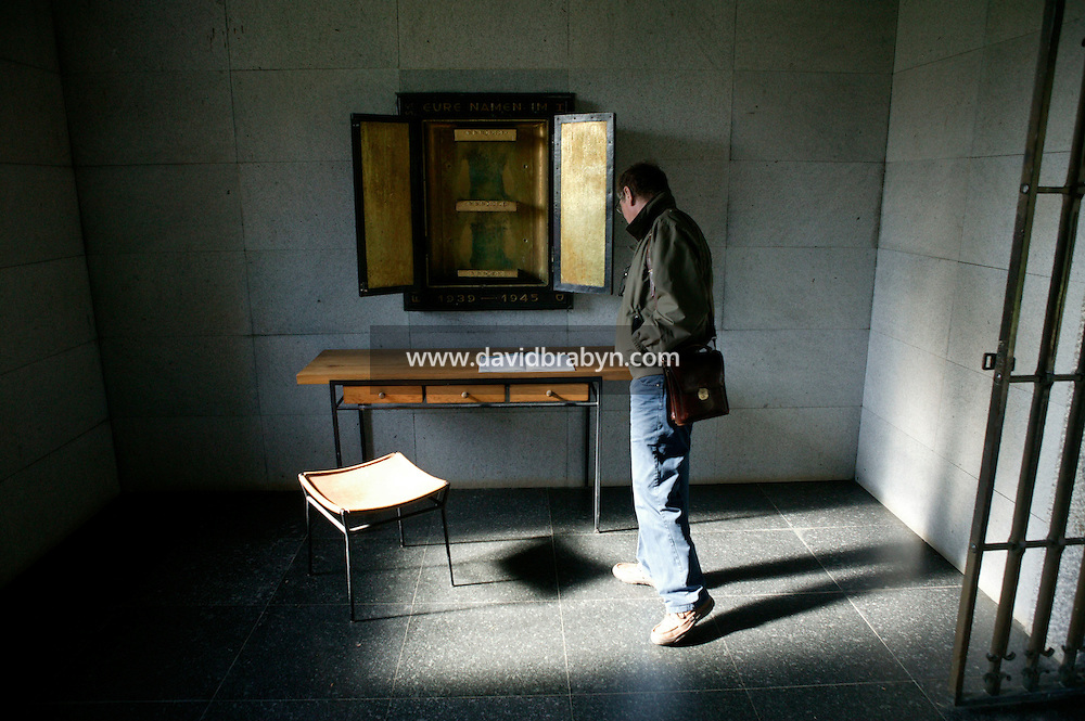 25 April 2004 - La Cambe, France - A visitor looks at the Visitor's Book of the German military cemetary in La Cambe, France, 25 April 2004. With over 21 200 tombs, this cemetary is the largest German military cemetary of the region.