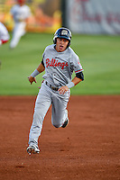 Alejo Lopez (5) of the Billings Mustangs  hustles towards third base against the Orem Owlz in Pioneer League action at Home of the Owlz on July 25, 2016 in Orem, Utah. Orem defeated Billings 6-5. (Stephen Smith/Four Seam Images)