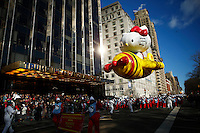 USA, New York, Nov 28, 2013. The Hello Kitty balloon floats while people take part in the 87th Macy's Thanksgiving Day Parade in New York City. Photo by VIEWpress/Eduardo Munoz Alvarez