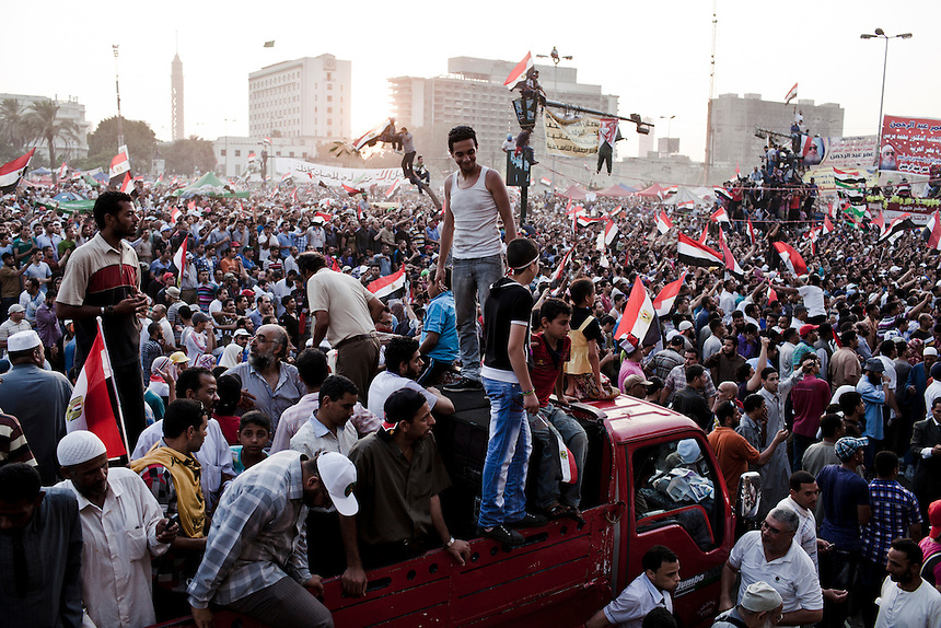 Egyptians gather in Tahrir Square to see the first public speech by Egypt's President-elect Mohammed Morsi on June 29, 2012 in Cairo, Egypt. Photo: Ed Giles.