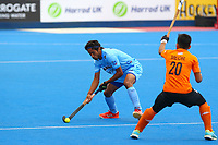 Sumit of India passes beyond Meor of Malaysia during the Hockey World League Quarter-Final match between India and Malaysia at the Olympic Park, London, England on 22 June 2017. Photo by Steve McCarthy.