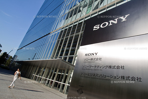 August 2, 2012 - Tokyo, Japan - A woman walks out of the Sony Corp. headquarters in downtown Tokyo. Sony, Japan's leading exporter of electronics, slashes its profit forecast due to slowing demand and strong yen. Sony reported a net loss of 24.6 billion yen ($316 million USD) in the first quarter as this is the company's fourth straight, full year loses in a row. (Photo by Christopher Jue/AFLO)