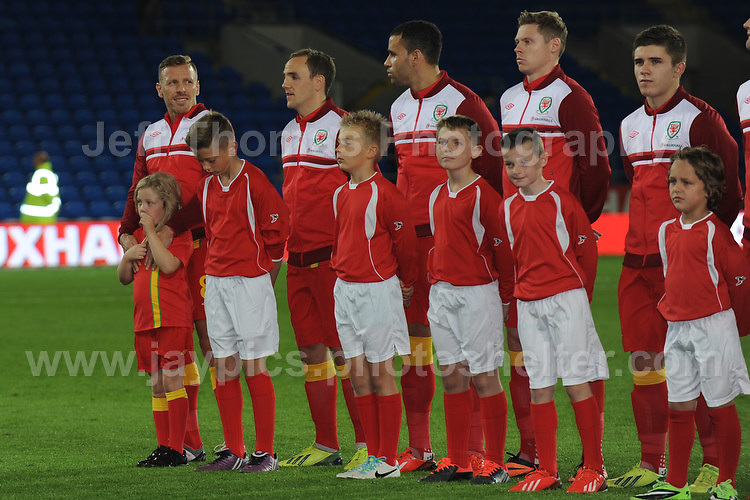Cardiff City Stadium, Friday 11th Oct 2013. At the end of the line is retiring Craig Bellamy accompanied with his Daughter during the Wales v Macedonia FIFA World Cup 2014 Qualifier match at Cardiff City Stadium, Cardiff, Friday 11th Oct 2014. All images are the copyright of Jeff Thomas Photography-07837 386244-www.jaypics.photoshelter.com