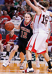 SIOUX CITY, IA - MARCH 13, 2009 --  Jacci Tinkel #12 of Sterling College drives toward Kristin Neth #15 of Northwestern (IA) during their game at the 2009 NAIA DII Women's Basketball National Championship at the Tyson Events Center. (Photo by Dick Carlson/Inertia)