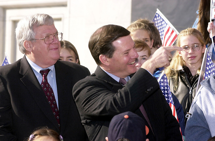 4taxpc020701 -- Rep. Tom Delay, R-TX, recognizes someone at a press conference in which House Republicans pointed out the benefits of Bush's tax cut proposal.  Alongside him is Speaker Dennis Hastert, R-IL.