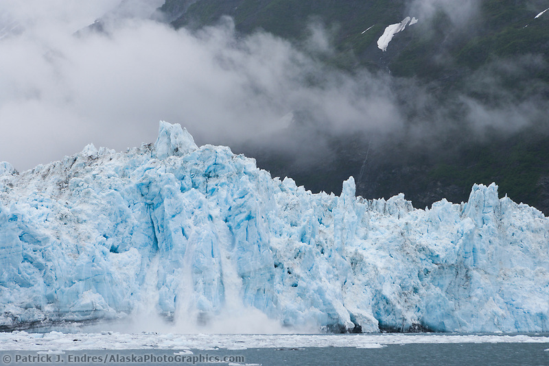 Coastal landscape of clouds hanging over the Surprise tidewater glacier in Harriman Fjord, Prince William Sound, Alaska