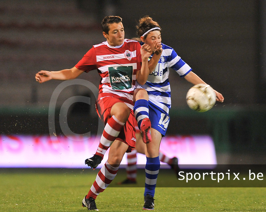 20130913 - ANTWERPEN , BELGIUM : Antwerp Charlotte Andries (left) pictured with Gent's Elke Van De Sompel (right) during the female soccer match between Royal Antwerp FC Vrouwen / Ladies and K AA Gent Ladies at the BOSUIL STADIUM , of the fourth matchday in the BENELEAGUE competition. Friday 13 September 2013. PHOTO DAVID CATRY