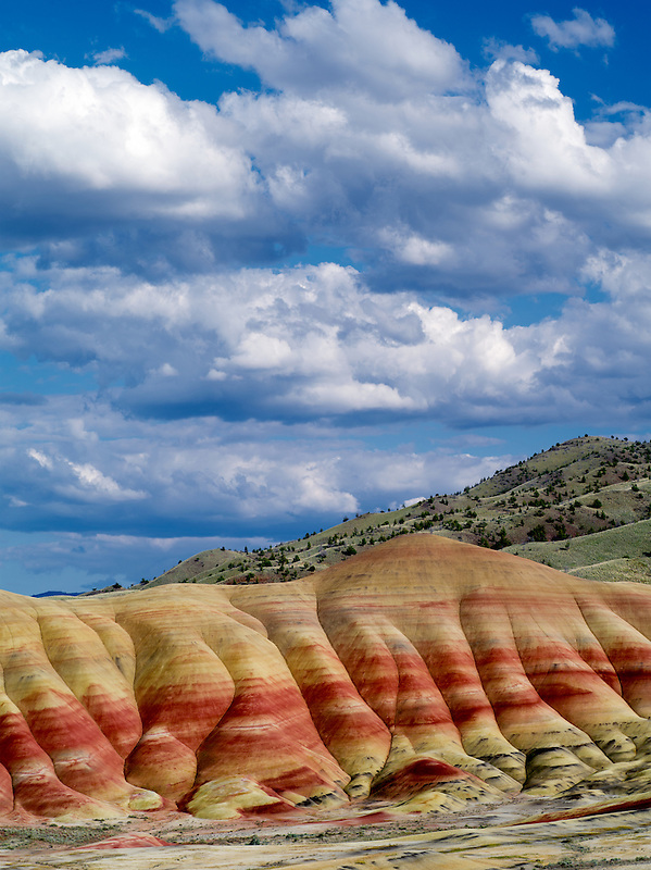 Puffy clouds over Painted Hills. John Day Fossil Beds National Monument. Oregon