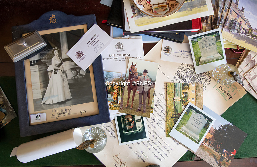 BNPS.co.uk (01202 558833)<br /> Pic: PhilYeomans/BNPS<br /> <br /> Thomas's bureau contain's reminders of his Royal life..<br /> <br /> A remarkable 'time warp' Royal archive amassed by the Queen's dressmaker has been found inside his old country home.<br /> <br /> The late Ian Thomas was a dress designer for members of the Royal Family, including Her Majesty, for over 30 years.<br /> <br /> As an apprentice he worked alongside the renowned fashion designer Norman Hartnell on creating the Queen's coronation dress in 1953.<br /> <br /> His archive includes embroidered samples of the gown worn by Elizabeth II for the historic ceremony in Westminster Abbey that was broadcast to millions.<br /> <br /> Mr Thomas also designed outfits for the Queen Mother and Princess Margaret.