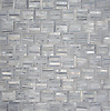 Wicker, a hand-cut tumbled mosaic, shown in Greystoke, is part of the Tissé® collection for New Ravenna..