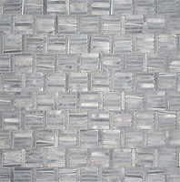 Wicker, a hand-cut tumbled mosaic, shown in Greystoke, is part of the Tissé™ collection for New Ravenna.