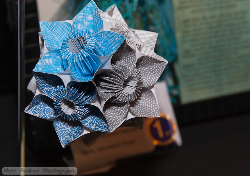"""Michelle won first place  at the 2011 OC Fair for a kusudama (ball origami) project made from recycled security envelopes.  This is a closeup of her project, where you can see the different security envelope patterns she used.  Each individual unit of each flower was folded from a 4""""x4"""" square of paper cut out from a security envelope we'd received in the mail."""