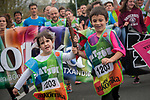 "Two children carry the baton as they run on the 20th Korrika.  Irun (Basque Country). April 4, 2017. The ""Korrika"" is a relay course, with a wooden baton that passes from hand to hand without interruption, organised every two years in a bid to promote the basque language. The Korrika runs over 11 days and 10 nights, crossing many Basque villages and cities. This year was the 20th edition and run more than 2500 Kilometres. Some people consider it an honour to carry the baton with the symbol of the Basques, ""buying"" kilometres to support Basque language teaching. (Gari Garaialde / Bostok Photo)"