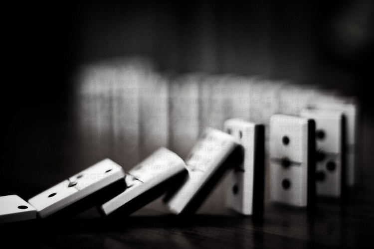 The domino effect in black and white