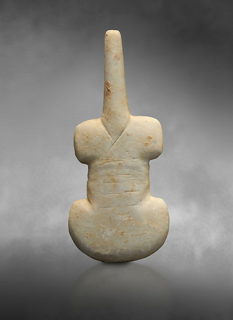 Cycladic violin shaped figurine. Early Cycladic Period I (Grotta-Pelos Phase 3200-2800 BC). National Archaeological Museum, Athens.   Gray background.