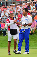 Hideki Matsuyama (JPN) shakes hands with his caddie following Sunday's final round of the World Golf Championships - Bridgestone Invitational, at the Firestone Country Club, Akron, Ohio. 8/6/2017.<br /> Picture: Golffile | Ken Murray<br /> <br /> <br /> All photo usage must carry mandatory copyright credit (&copy; Golffile | Ken Murray)