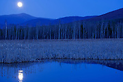 Pondicherry Wildlife Refuge - May 5, 2012 full moon (supermoon) over Mount Washington from along the Presidential Range Rail Trail / Cohos Trail near Cherry Pond in Jefferson, New Hampshire USA during the spring months. The biggest full moon of 2012.