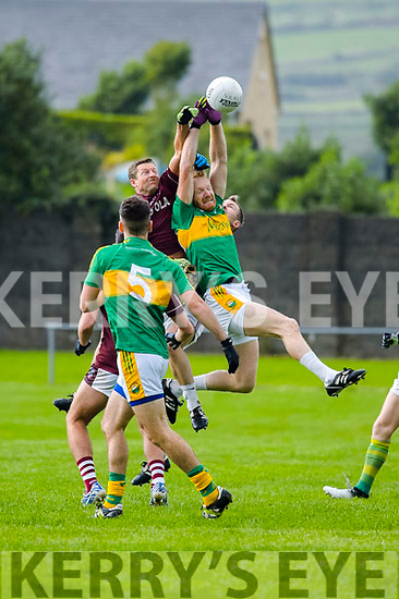 Aidan Dash O'Sullivan of Skellig Rangers rises to the ball ahead of Denis Shine O'Sullivan of Dromid Pearses in the Junior Premier Football Championship Semi Final in Cahersiveen.