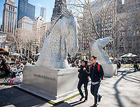 "Two 15 foot tall horse head sculptures are seen displayed in Bryant Park in New York on Friday, March 21, 2014. The sculpture is part of the Tartan Week activities which celebrate all things Scottish. The horse heads are 1:10 scale miniatures of ""The Kelpies"", monumental 100 foot tall sculptures, the largest equine sculptures in the world, by the artist Andy Scott which are displayed in the Helix in Falkirk, Scotland. The horses depict supernatural water horses from Celtic folklore. Tartan Week in New York concludes with the Tartan Day Parade. (© Richard B. Levine)"