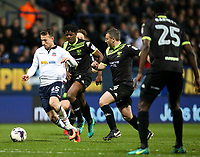 Bolton Wanderers' Adam Le Fondre gets away from Bury's Paul Caddis and Greg Leigh<br /> <br /> Photographer Alex Dodd/CameraSport<br /> <br /> The EFL Sky Bet League One - Bolton Wanderers v Bury - Tuesday 18th April 2017 - Macron Stadium - Bolton<br /> <br /> World Copyright &copy; 2017 CameraSport. All rights reserved. 43 Linden Ave. Countesthorpe. Leicester. England. LE8 5PG - Tel: +44 (0) 116 277 4147 - admin@camerasport.com - www.camerasport.com