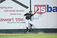 Great Falls Voyagers left fielder Tracy Hadley (1) makes a catch up against the outfield wall during the game against the Helena Brewers at Centene Stadium on August 19, 2017 in Helena, Montana.  The Voyagers defeated the Brewers 8-7.  (Brian Westerholt/Four Seam Images)