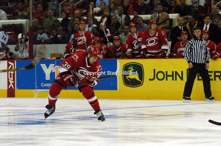 Doug Weight watches his first goal scored as a Carolina Hurricane hit the net against the New York Rangers Tuesday, March 14, 2006 at the RBC Center in Raleigh, NC. Carolina won 5-3.