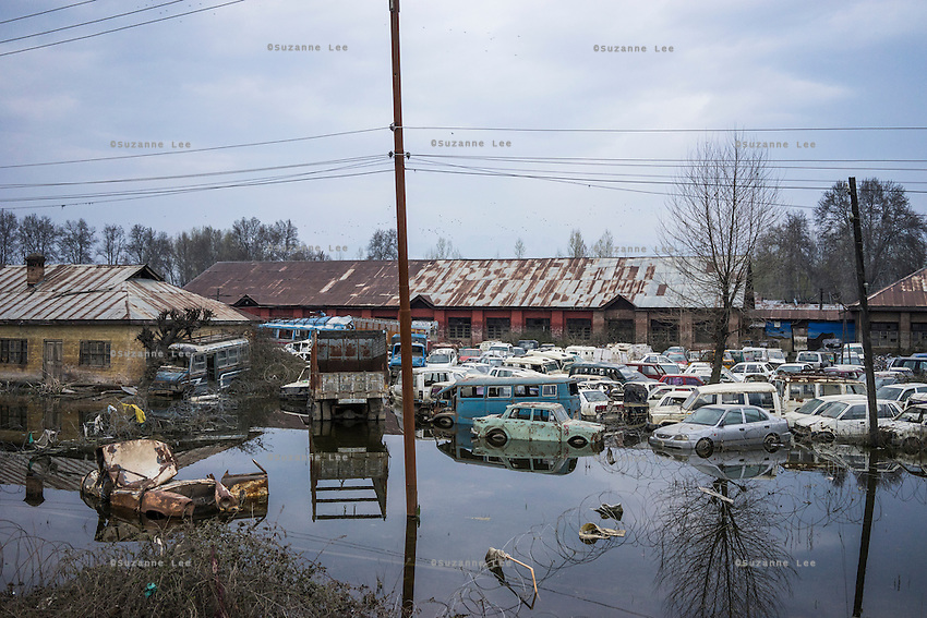damaged cars pile up in flood waters as homes wait to be repaired after the devastating floods that decimated Srinagar, the capital of Jammu and Kashmir, India, on 24th March 2015. Nearly 2500 villagers including Srinagar, the capital of the state of Jammu and Kashmir, was devastated by severe floods and landslides in September 2014 the worst in 60 years, displacing millions of people, many of them children. Photo by Suzanne Lee for Save the Children