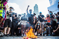 NEW YORK, NY - JULY 4: A group of protesters gather at Columbus Circle to burn some flags of the United States during a Black Lives Matter protest in New York, NY on July 4, 2020. Protests continue in New York and all movements and actions take place in the context of protests against the murder of George Floyd and other African Americans by the police in the United States. (Photo by Pablo Monsalve / VIEWpress via Getty Images)