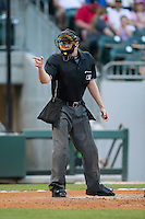 Home plate umpire John Bacon makes a strike call during the International League game between the Columbus Clippers and the Charlotte Knights at BB&T BallPark on May 3, 2016 in Charlotte, North Carolina.  The Clippers defeated the Knights 8-3.  (Brian Westerholt/Four Seam Images)
