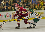 20 February 2016: Boston College Eagle Forward Colin White, a Freshman from Hanover, MA, keeps the puck away from University of Vermont Catamount Forward Travis Blanleil, a Sophomore from Kelowna, British Columbia, during the first period at Gutterson Fieldhouse in Burlington, Vermont. The Eagles defeated the Catamounts 4-1 in the second game of their weekend series. Mandatory Credit: Ed Wolfstein Photo *** RAW (NEF) Image File Available ***