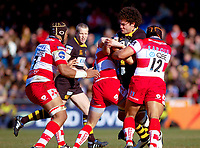 Dan Leo attracts the attention of three Gloucester tacklers. Guinness Premiership match between London Wasps and Gloucester on March 7, 2010 at Adams Park in High Wycombe, England. [Mandatory Credit: Patrick Khachfe/Onside Images]