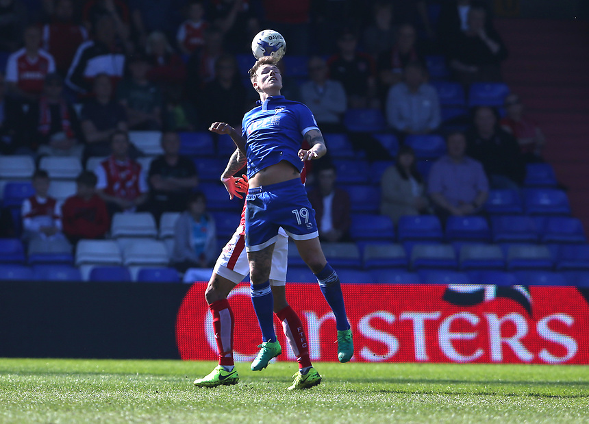 Oldham Athletic's Lee Erwin out jumps Fleetwood Town's Nathan Pond<br /> <br /> Photographer Stephen White/CameraSport<br /> <br /> The EFL Sky Bet League One - Oldham Athletic v Fleetwood Town - Saturday 8th April 2017 - SportsDirect.com Park - Oldham<br /> <br /> World Copyright &copy; 2017 CameraSport. All rights reserved. 43 Linden Ave. Countesthorpe. Leicester. England. LE8 5PG - Tel: +44 (0) 116 277 4147 - admin@camerasport.com - www.camerasport.com