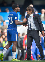 Chelsea manager Antonio Conte with goalscorer Michy Batshuayi of Chelsea at full time during the Premier League match between Chelsea and Watford at Stamford Bridge, London, England on 21 October 2017. Photo by Andy Rowland.