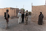 12/08/14  Iraq -- Daquq, Iraq -- Peshmerga fighters with civilians in the village outside the base in Daquq.