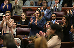 Supporters, including Assemblywoman Shea Backus, D-Las Vegas, center, applaud during Nevada Gov. Steve Sisolak's State of the State address to the Legislature in Carson City, Nev., on Wednesday, Jan. 16, 2019. (Cathleen Allison/Las Vegas Review-Journal)