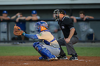 Bluefield Blue Jays catcher Matt Morgan (7) reaches for a pitch as home plate umpire Mark Stewart looks on during the game against the Burlington Royals at Burlington Athletic Stadium on June 28, 2016 in Burlington, North Carolina.  The Royals defeated the Blue Jays 4-0.  (Brian Westerholt/Four Seam Images)