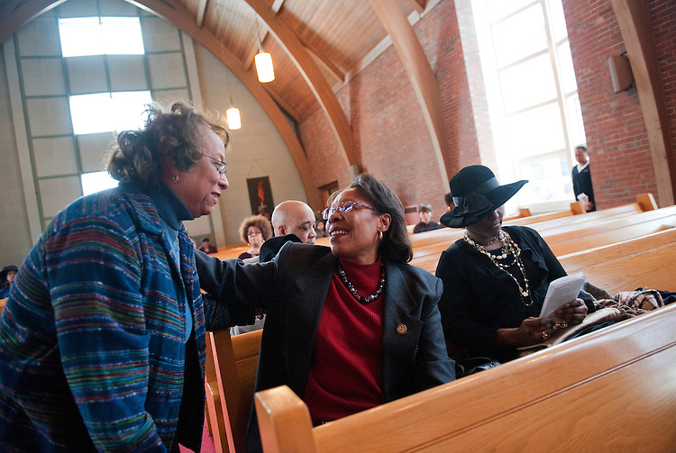 UNITED STATES - FEBRUARY 12:  Rep. Marcia Fudge, D-Ohio, center, greets Patsy Harris, left, before a Sunday service at Mt. Zion Congregational Church in Cleveland, Ohio.  Michelle Felder of Fudge's staff appears at right. (Photo By Tom Williams/CQ Roll Call)