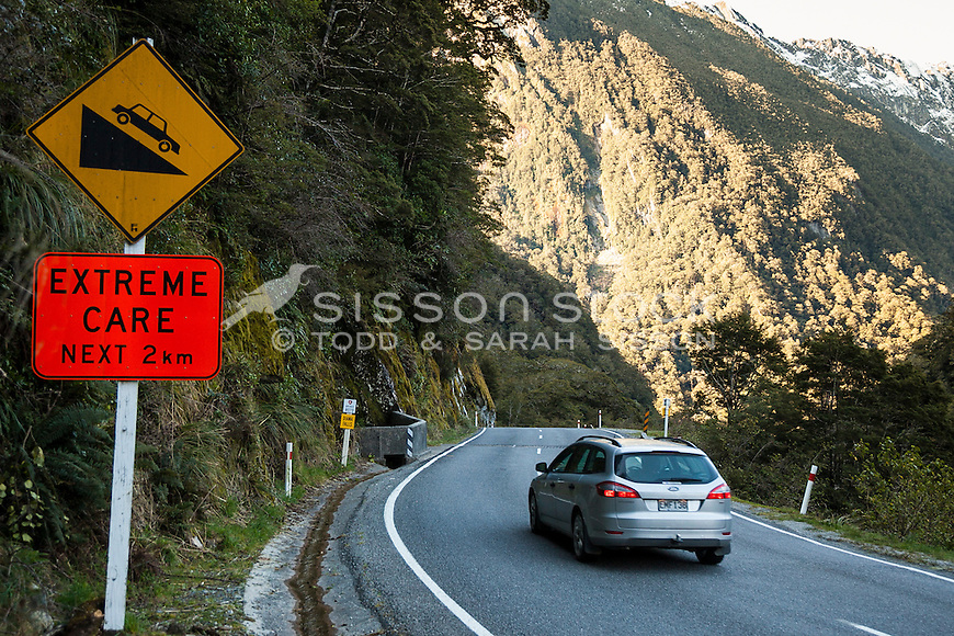 New Zealand road sign - extreme care next 2 km - Haast Pass, West Coast South Island NZ.