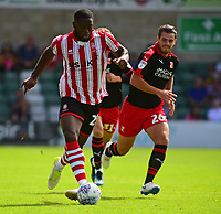 Lincoln City's John Akinde gets past Swindon Town's Dion Conroy<br /> <br /> Photographer Andrew Vaughan/CameraSport<br /> <br /> The EFL Sky Bet League Two - Lincoln City v Swindon Town - Saturday August 11th 2018 - Sincil Bank - Lincoln<br /> <br /> World Copyright &copy; 2018 CameraSport. All rights reserved. 43 Linden Ave. Countesthorpe. Leicester. England. LE8 5PG - Tel: +44 (0) 116 277 4147 - admin@camerasport.com - www.camerasport.com