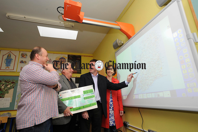 Steve Greenan, co-chair of St Joseph's NS, Miltown Malbay, parents association, John Reidy, chairman of the board of management, Aidan Looney, principal, and Edel Lynch, deputy principal and treasurer of the board of management at their open evening for the new interactive whiteboards. Photograph by John Kelly.