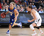 SIOUX FALLS, SD - MARCH 10: Macy Miller #12 from South Dakota State University drives past Tia Hemiller #4 from the University of South Dakota in the first half of the Summit League Championship Tournament game Tuesday at the Denny Sanford Premier Center in Sioux Falls, SD. (Photo by Dick Carlson/Inertia)