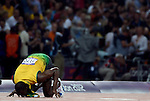 LONDON, ENGLAND - AUGUST 9:  Usain Bolt of Jamacia kisses the track after the 200 meter finals during the Athletics Competition, Day 14 of the London 2012 Olympic Games on August 8, 2012 at Olympic Park in London, England. (Photo by Donald Miralle)