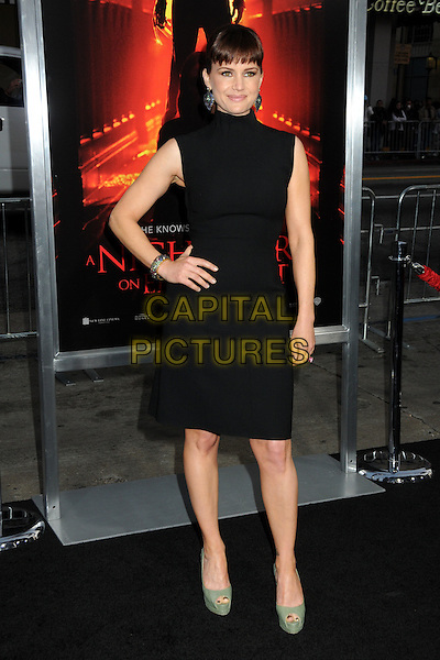 "CARLA GUGINO .""A Nightmare On Elm Street"" Los Angeles Premiere held at Grauman's Chinese Theatre, Hollywood, California, USA, 27th April 2010..full length black dress hand on hip sleeveless green platform peep toe shoes .CAP/ADM/BP.©Byron Purvis/AdMedia/Capital Pictures."