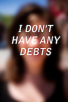 "Anonymous portrait taken in Cambridge, Massachusetts, USA,  paired with text answering the question: How much do you owe?  The project was produced as a look at personal debt for Longshot Magazine #2.  ..The person's response here reads: ""I don't have any debts"""