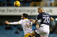 Steve Morison of Millwall beats Frederico Venâncio of Sheffield Wednesday to the ball during the Sky Bet Championship match between Millwall and Sheff Wednesday at The Den, London, England on 20 February 2018. Photo by Carlton Myrie.