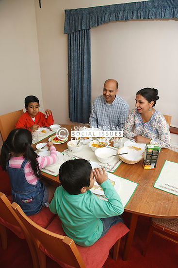 Asian family at dining room table.