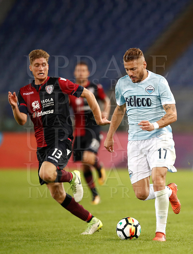 Calcio, Serie A: Roma, stadio Olimpico, 22 ottobre 2017.<br /> Lazio's Ciro Immobile (r) in action with Cagliari's Filippo Romagna (l) during the Italian Serie A football match between Lazio and Cagliari at Rome's Olympic stadium, October 22, 2017.<br /> UPDATE IMAGES PRESS/Isabella Bonotto