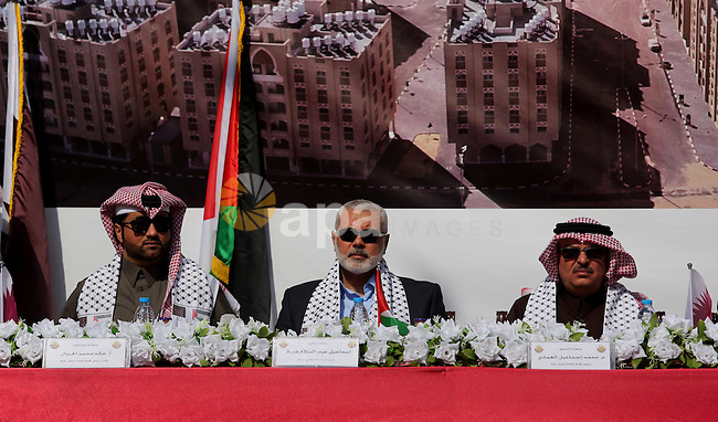 Hamas leader Ismail Haniyeh and Qatar's Ambassador to the Palestinian Authority, Mohammed Al Emadi attend the ceremony of the second phase of the Sheikh Hamad Town, in Khan Younis in the southern Gaza strip, on February 11, 2017. Photo by Ashraf Amra