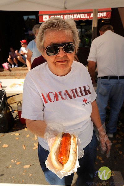 32nd Annual Selinsgrove Market Street Festival. Red cross volunteer selling hotdog.