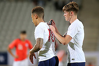 Tom Pearce of Leeds United puts a tracking device in the shirt of Middlesbrough's Marcus Tavernier during Chile Under-21 vs England Under-20, Tournoi Maurice Revello Football at Stade Parsemain on 7th June 2019